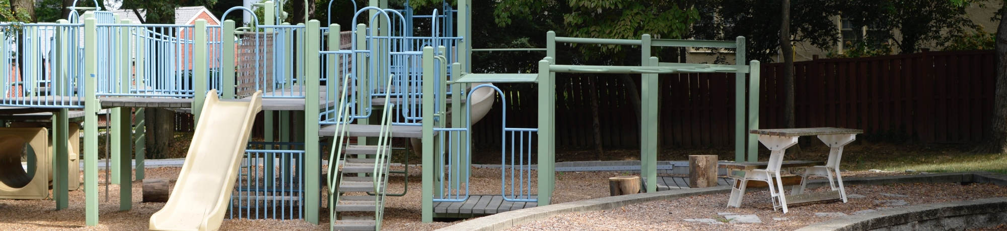 playground structure with slides and climbing bars